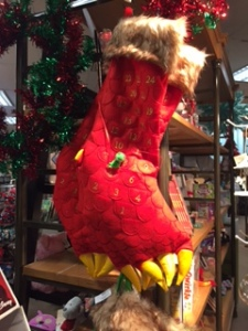 A dinosaur foot stocking and advent calendar.